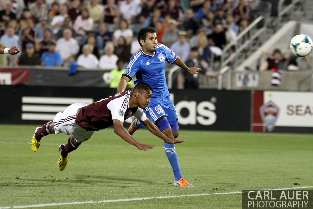 June 15th, 2013 - Colorado Rapids midfielder Jaime Castrillon (23) dives in for a header attempt in the second half of the MLS match between San Jose Earthquake and the Colorado Rapids at Dick's Sporting Goods Park in Commerce City, CO