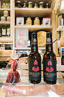 "NAPLES, ITALY - 4 JANUARY 2019: Bottles of the artisan beer ""Janarius"", made for the restaurant, are seen here on the cold-cut counter of Janarius, a restaurant in Naples, Italy, on January 4th 2019.<br /> <br /> Janarius is a typical Neapolitan gourmet restaurant and shop founded by Francesco Andoli in September 2018 in via Duomo, in front of the Naples's Duomo and treasure of Saint Janarius. Saint Janarius is the patron saint of Naples."