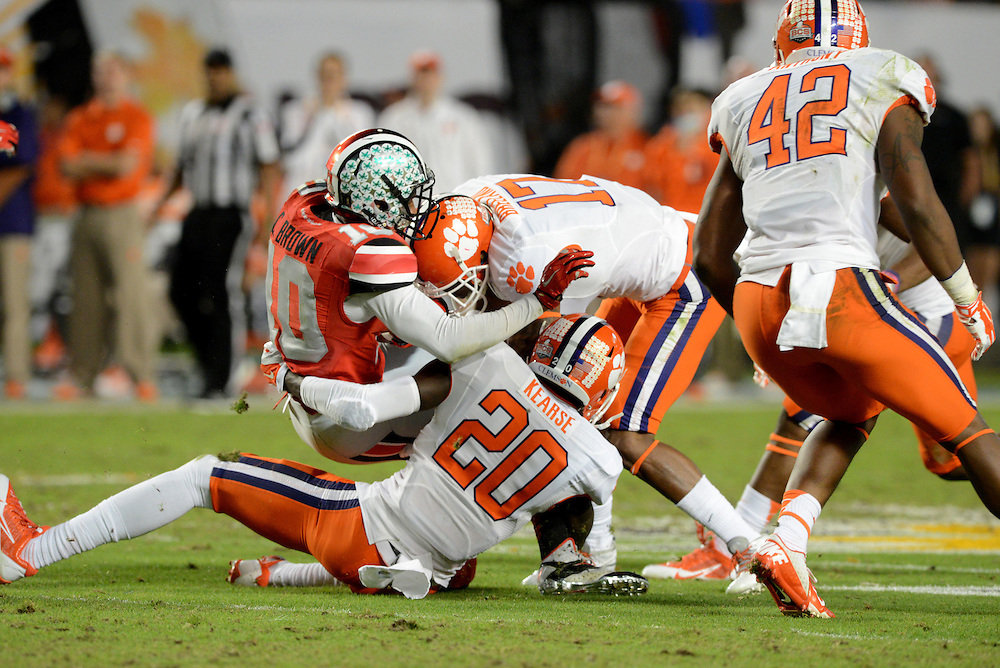 January 3, 2014: Jayron Kearse #20 and Bashaud Breeland #17 of Clemson tackle Corey Brown #10 of Ohio State during the NCAA football game between the Clemson Tigers and the Ohio State Buckeyes at the 2014 Orange Bowl in Miami Gardens, Florida.  The Tigers defeated the Buckeyes 40-35.