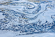 Abstract pattern of water swirling in Liscombe River<br />Liscombe<br />Nova Scotia<br />Canada