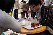 young adults text messaging in a bar Japan Tokyo