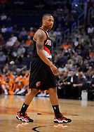Oct. 12, 2012; Phoenix, AZ, USA; Portland Trail Blazers guard Damian Lillard (0) reacts on the court during the game against the Phoenix Suns at US Airways Center. The Suns defeated the Trail Blazers 104-93.  Mandatory Credit: Jennifer Stewart-US PRESSWIRE.