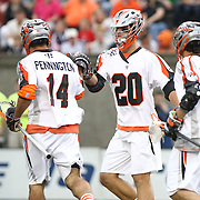 Jeremy Sieverts #20 of the Denver Outlaws celebrates with his teammates during the game at Harvard Stadium on May 10, 2014 in Boston, Massachusetts. (Photo by Elan Kawesch)