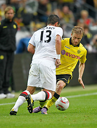 "04.08.2010, Signal Iduna Park, Dortmund, GER, Freundschaftsspiel, Borrussia Dortmund vs Manchester City, im Bild:Jakub Blaszczykowski ""Kuba"" (Dortmund POL #16) vs Alexander Kolarov  (Manchester City #13),  EXPA Pictures © 2010, PhotoCredit: EXPA/ nph/  Scholz *** Local Caption ***+++++ ATTENTION - OUT OF GER +++++ / SPORTIDA PHOTO AGENCY"