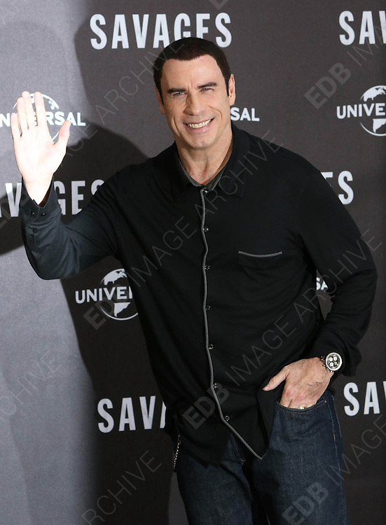 17.SEPTEMBER.2012. BERLIN<br /> <br /> JOHN TRAVOLTA ATTENDS THE PHOTOCALL FOR THE &quot;SAVAGES&quot; HELD AT THE RITZ CARLTON HOTEL IN BERLIN. <br /> <br /> BYLINE: EDBIMAGEARCHIVE.CO.UK<br /> <br /> *THIS IMAGE IS STRICTLY FOR UK NEWSPAPERS AND MAGAZINES ONLY*<br /> *FOR WORLD WIDE SALES AND WEB USE PLEASE CONTACT EDBIMAGEARCHIVE - 0208 954 5968*