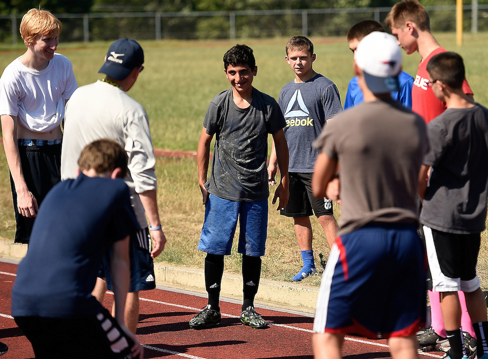 7/21/16 :: REGION :: LYNCH :: Hanif Mahmoud is introduced by Ledyard soccer coach Bill Glenney following a pre-season workout at Ledyard High School Thursday, July 21, 2016. Hasan Mahmoud and Fahima Jemmo and their children Fidan, 17, Hanif, 15 and Fulla, 7, are refugees from the conflict in Syria and lived for three years in Turkey before finally receiving approval to come to the United States. (Sean D. Elliot/The Day) (Sean D. Elliot/The Day)