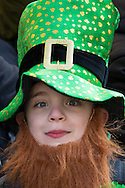 A young leprechaun watches the procession during the St Patrick's Day Parade in Westminster, London.<br /> Picture by Paul Davey/Focus Images Ltd +447966 016296<br /> 13/03/2016