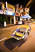 Rickshaw at night.