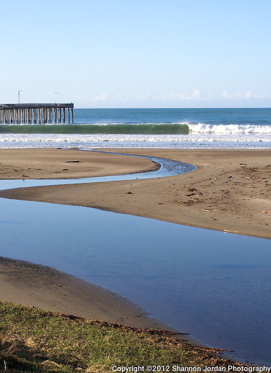 A wave breaks North of  the Cayucos pier in California.
