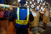 police in New York city protecting the pedestrians during the Christmas crowd shopping time