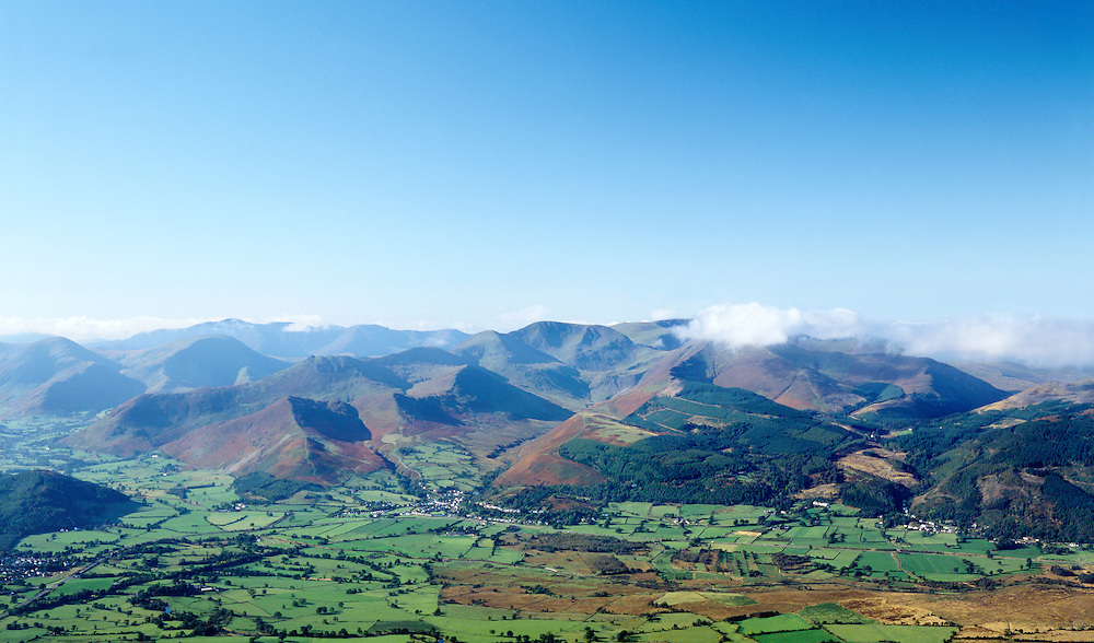 The Lake District National Park. The NW fells. SW from Skiddaw over Braithwaite village, Causey Pike, Grasmoor, Grisedale Pike