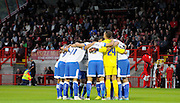 Portsmouth huddle together before the Sky Bet League 2 match between Crawley Town and Portsmouth at the Checkatrade.com Stadium, Crawley, England on 18 August 2015. Photo by Michael Hulf.
