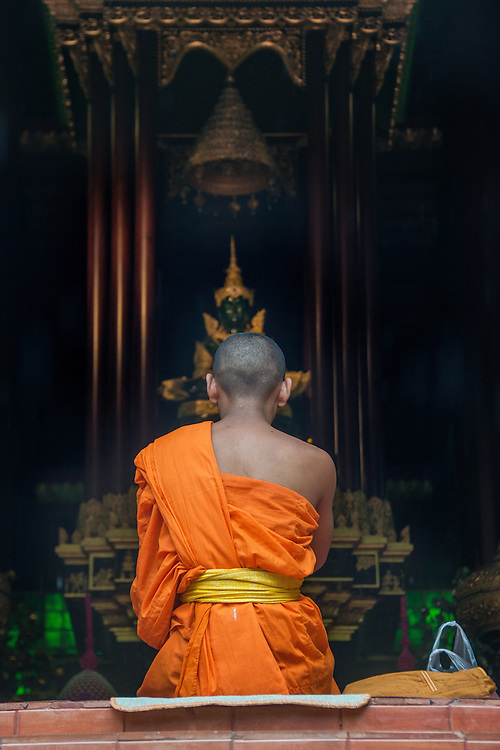 A monk prays in Chiang Mai, Thailand