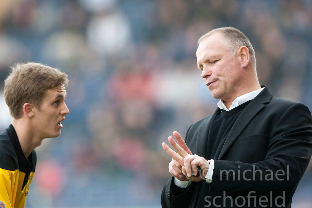 Livingston's manager John Hughes with Livington's Robert Barr..Falkirk 2 v 5 Livingston, 24/3/2012. .©Michael Schofield.