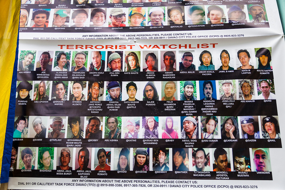Davao City, Mindanao, Philippines - JUNE 24: A Poster of Wanted Terrorists are posted at Mini Forest Barangay 23C.  Thousands have fled Marawi to flee the ongoing conflict after the ISIS backed Maute Group has sieged the city.  Currently, over 570 families and roughly 2500 evacuees from Marawi reside in the Mini Forest.