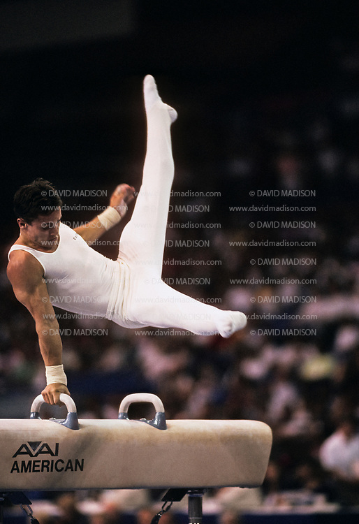 SEATTLE - JULY 1990:  Csaba Fajkusz of Hungary performs on the pommel horse during the Men's Gymnastics competition of the 1990 Goodwill Games held from July 20 - August 5, 1990.  The gymnastics venue was the Tacoma Dome in Tacoma, Washington.  (Photo by David Madison/Getty Images)
