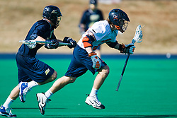 Virginia attackman Ryan Kelly (22) runs past Navy defenseman Jordan Dinola (3).  The Virginia Cavaliers scrimmaged the Navy Midshipmen in lacrosse at the University Hall Turf Field  in Charlottesville, VA on February 2, 2008.