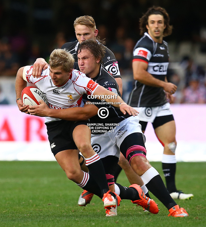 DURBAN, SOUTH AFRICA - AUGUST 22:  Etienne Oosthuizen of the Cell C Sharks tackling Jaco van der Walt of the Xerox Golden Lions during the Absa Currie Cup match between Cell C Sharks and Xerox Golden Lions at Growthpoint Kings Park on August 22, 2015 in Durban, South Africa. (Photo by Steve Haag/Gallo Images)