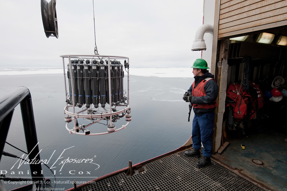 Zachary Spence directs the launch of a water collection device called a CTD off of the US Coast Gaurd ship Polar Sea into the Arctic Ocean.