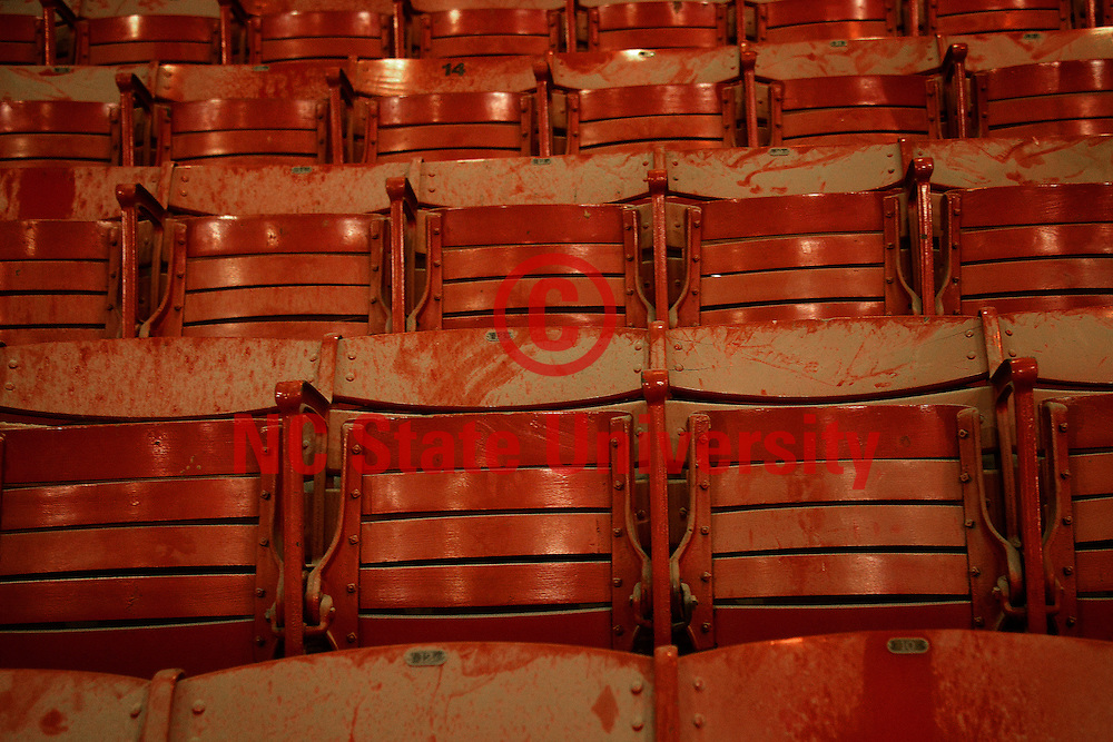 Construction dust covers some of the original red seats still in Reynolds Coliseum.
