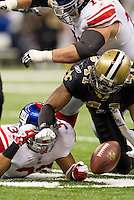 28 November 2011: Safety (41) Roman Harper of the New Orleans Saints reaches for and grabs a fumble against the New York Giants during the second half of the Saints 49-24 victory over the Giants at the Mercedes-Benz Superdome in New Orleans, LA.