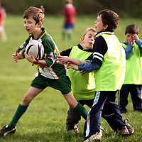Jen Ligtvoet and Kevin McSweeney try to stop the advances of Sean Cahill at the East Clare Eagles rugby training in Tulla on Saturday morning.<br /><br />Photograph by Yvonne Vaughan.