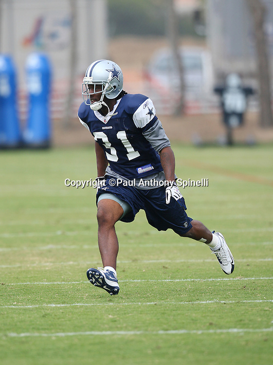 OXNARD, CA - AUGUST 01:  Rookie cornerback Mike Jenkins #31 of the Dallas Cowboys makes a move toward the ball in pass coverage during the 2008 Dallas Cowboys Training Camp at River Ridge Field on August 1, 2008 in Oxnard, California. ©Paul Anthony Spinelli *** Local Caption *** Mike Jenkins
