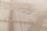 Crew of Tallship 'Eagle'  furls sails in fog, tallships 2004 parade of sail, Newport, RI, USA