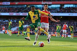 Martin Olsson of Norwich City holds back Laurent Koscielny of Arsenal - Mandatory byline: Jason Brown/JMP - 07966386802 - 30/04/2016 - FOOTBALL - Emirates Stadium - London, England - Arsenal v Norwich City - Barclays Premier League