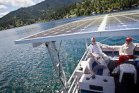 Richard Trudell designed his solar-powered pontoon boat so he could enjoy quiet  outings on the lake with his wife Nancy Morrison and friends. On a sunny day, the boat can mosey through the water and not rely on the six batteries onboard that provide an additional 25 mile range.