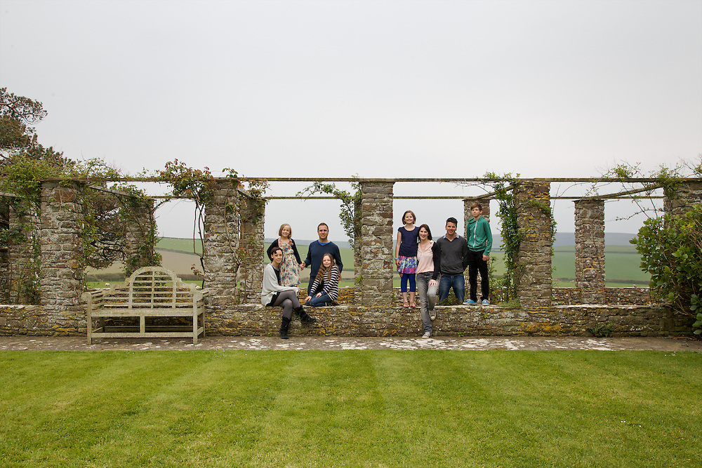 The Elliott and Baker families in the rose arbour at Pickwell Manor. From left to right: Tracey Elliott, Millie-grace Elliott (8), Richard Eliott, Molly Elliott (10), Liza Baker (9), Susannah Baker, Steve Baker, Zac Baker (11). Pickwell Manor, Georgeham, North Devon, UK.<br /> CREDIT: Vanessa Berberian for The Wall Street Journal<br /> HOUSESHARE