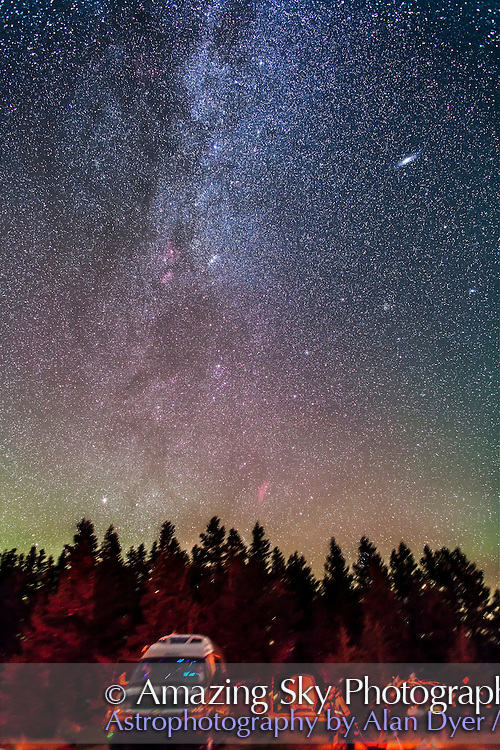The autumn Milky Way rising, from Cypress Hills, Saskatchewan at the Summer Star Party, August 2012. This is a stack of 5 x 2 minute exposures, tracked, at ISO 1600 with the Canon 24mm lens at f/2.8 and Canon 5D MkII camera. The ground is from one exposure. A faint aurora adds the horizon tint.