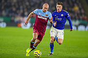 Leicester City midfielder Harvey Barnes (15) tussles with West Ham United defender Pablo Zabaleta (5) during the Premier League match between Leicester City and West Ham United at the King Power Stadium, Leicester, England on 22 January 2020.