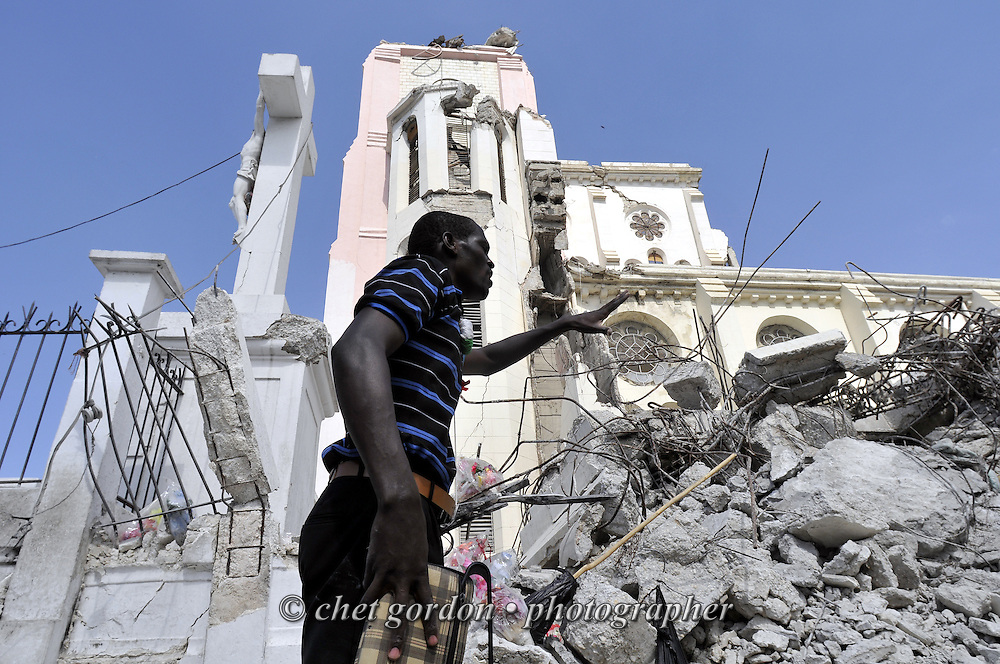 A man gestures outside the collapsed Cathedral in Port-au-Prince, Haiti on Saturday, January 30, 2010. A massive 7.0 earthquake struck the Caribbean island nation on January 12th., killing upwards of 200,000 people.