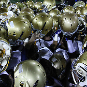 Salesianum players celebrate while holding their helmets in the air after defeating The Middletown Cavaliers 23-7 in the DIAA DIVISION I STATE CHAMPIONSHIP game Saturday, Nov. 30 2013, at Delaware Stadium in Newark Delaware.