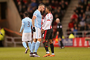 Manchester City defender Nicolas Otamendi and Sunderland forward Jermain Defoe   face off after Sunderland forward Jermain Defoe   challenge during the Barclays Premier League match between Sunderland and Manchester City at the Stadium Of Light, Sunderland, England on 2 February 2016. Photo by Simon Davies.