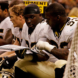 2009 September 03: New Orleans Saints defensive linemen Sedrick Ellis (98) and Bobby McCray (93) talk on the bench during a preseason game between the Miami Dolphins and the New Orleans Saints at the Louisiana Superdome in New Orleans, Louisiana.