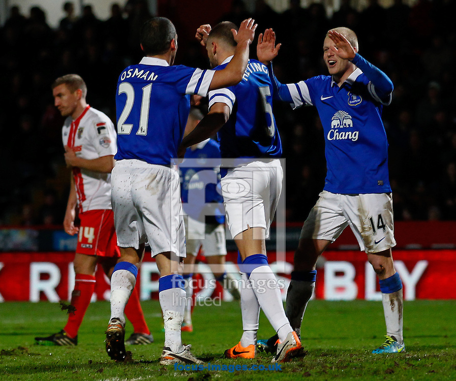 Picture by David Horn/Focus Images Ltd +44 7545 970036<br /> 25/01/2014<br /> John Heitinga of Everton (centre) celebrates scoring his team's third goal with Leon Osman of Everton (left) and Steven Naismith of Everton (right) during the The FA Cup match at the Lamex Stadium, Stevenage.