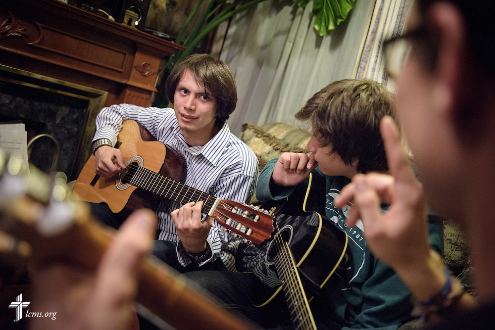Tyler McMiller (far right), LCMS missionary to Mexico, leads a music lesson for brothers following catechesis instruction at their home in Mexico City on Friday, Feb. 12, 2016.  LCMS Communications/Erik M. Lunsford