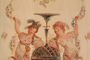 """Detail of a painted decorative wall panel depicting courtesans women, feathers in the hair, naked breasts, holding garlands of flowers, Turkish Boudoir, redesigned in 1777 for Marie Antoinette, by architect Richard Mique, Chateau de Fontainebleau, France. The decoration is the achievement of the brothers Rousseau, and the furniture dates to the period of the First Empire, with precious textile work done by Jacob-Desmalter for Empress Josephine. Including a small bedroom, mirrors, and curtains raised by pulleys, this exceptional ensemble has been restored in 2014 thanks to the support of INSEAD and the generosity of subscribers of sponsors belonging to the group """"Des Mécènes pour Fontainebleau"""". Its opening to the public is schedule for Spring 2015. Picture by Manuel Cohen"""