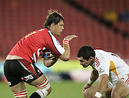 JOHANNESBURG, SOUTH AFRICA - 23 April 2011: Michael Rhodes of the Lions runs into Mike Delany during the Super Rugby Match between the MTN Lions and the Chiefs held at Coca Cola Park Stadium, Johannesburg, South Africa. Photo by Dominic Barnardt