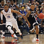Ryan Boatright, (right), UConn, drives past James Woodard, Tulsa, during the UConn Huskies Vs Tulsa Semi Final game at the American Athletic Conference Men's College Basketball Championships 2015 at the XL Center, Hartford, Connecticut, USA. 14th March 2015. Photo Tim Clayton