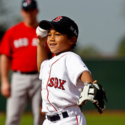 February 17, 2011; Fort Myers, FL, USA; D'Angelo Ortiz son of Boston Red Sox first baseman David Ortiz (not pictured) tosses the ball during spring training at the Player Development Complex.  Mandatory Credit: Derick E. Hingle
