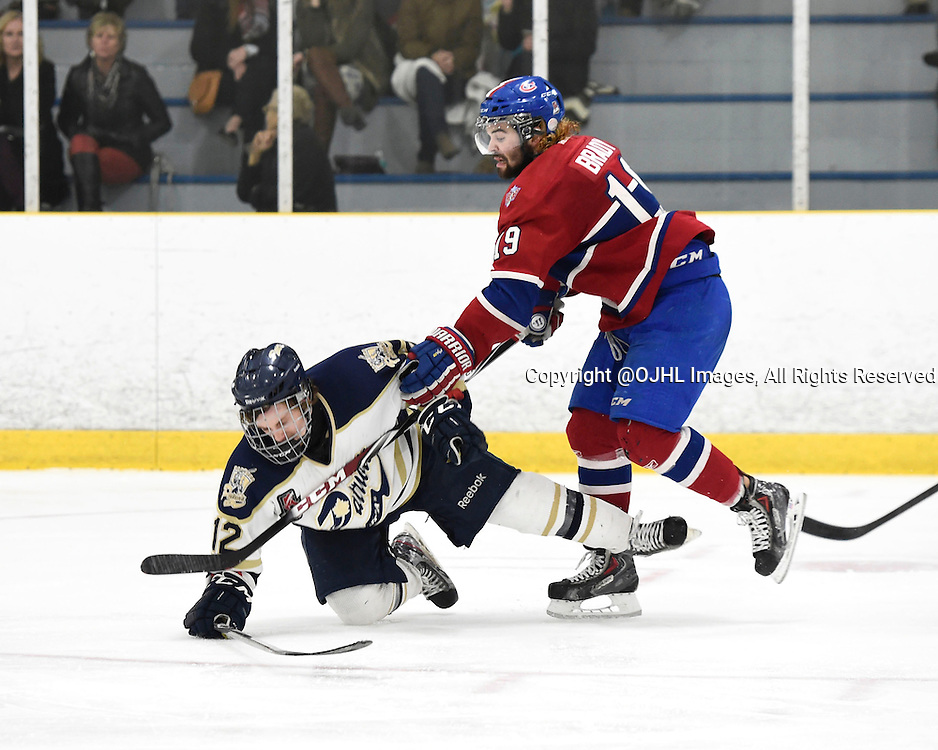 TORONTO, ON - Apr 15, 2015 : Ontario Junior Hockey League game action between the Toronto Patriots and the Kingston Voyaguers. Game three of the Buckland Cup Championship Series. Jacob Hayhurst #12 of the Toronto Patriots takes the hit from Adam Brady #19 of the Kingston Voyageurs during the second period.<br /> (Photo by Andy Corneau / OJHL Images)