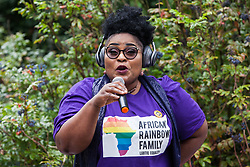 London, UK. 6 July, 2019. A speaker from African Rainbow Family (ARF), a not-for-profit charitable organisation that supports lesbian, gay, bisexual, transgender intersexual and queer (LGBTIQ) people of African heritage and from the wider Black Asian Minority Ethnic groups, addresses activists preparing to take part in a London Pride Solidarity March in solidarity with those for whom Pride in London is inaccessible and in protest against the corporatisation of Pride in London.