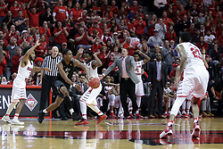 20 March 2017:  A.J. Davis bounce passes the ball by Paris Lee(1) during a College NIT (National Invitational Tournament) 2nd round mens basketball game between the UCF (University of Central Florida) Knights and Illinois State Redbirds in  Redbird Arena, Normal IL