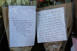 © Licensed to London News Pictures . 29/12/2018 . Wigan , UK . Tribute written from Billy's parents (right) left at the scene where police have taped off a stretch of Bickershaw Lane in Abram . GMP report they have arrested two people on suspicion of attempted murder and for conspiracy to commit attempted murder , respectively , after a 21-year-old man , identified locally as Billy Livesley , sustained life-threatening injuries yesterday evening (Friday 28th December 2018) . Photo credit : Joel Goodman/LNP