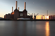 Long exposure shot of the River Thames opposite Battersea Power Station as the sun rises in the cold January sky