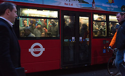© Licensed to London News Pictures. 05/02/2014. London, UK. A crowded number 25 bus in Bank in the City of London this morning. London Underground union members from the RMT and TSSA unions have gone on a 48 hour strike, which started at 9pm on 4th February 2014, over proposals by Transport for London (TfL) to cut jobs and close ticket offices. Photo credit : Vickie Flores/LNP