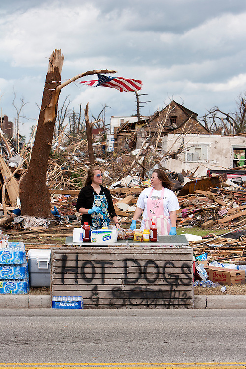 Women distribute free food and beverages to volunteers and residents helping to clean up Joplin, Missouri, May 25, 2011. On May 22, 2011, Joplin Missouri was devastated by an EF-5 tornado.